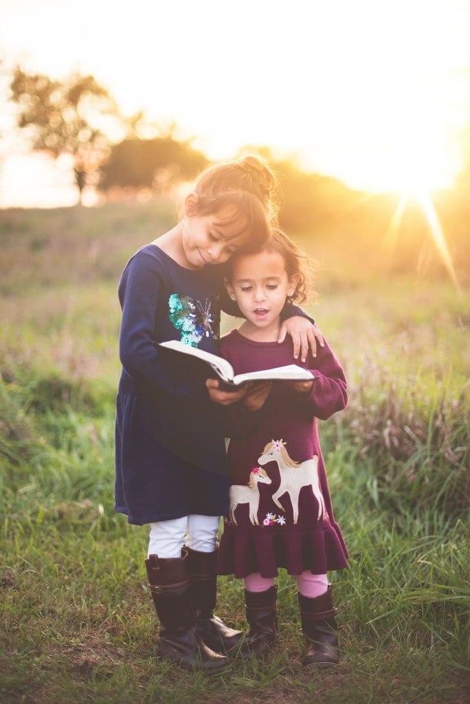 children reading together outside