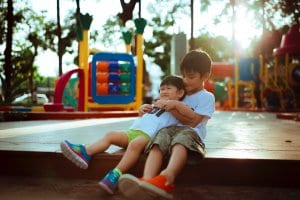 two young boys playing at a playground